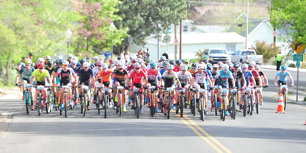 Men head up to the hills from downtown during the Whiskey Off Road 50-mile professional race in Prescott Sunday, April 29, 2018. (Les Stukenberg/Courier)