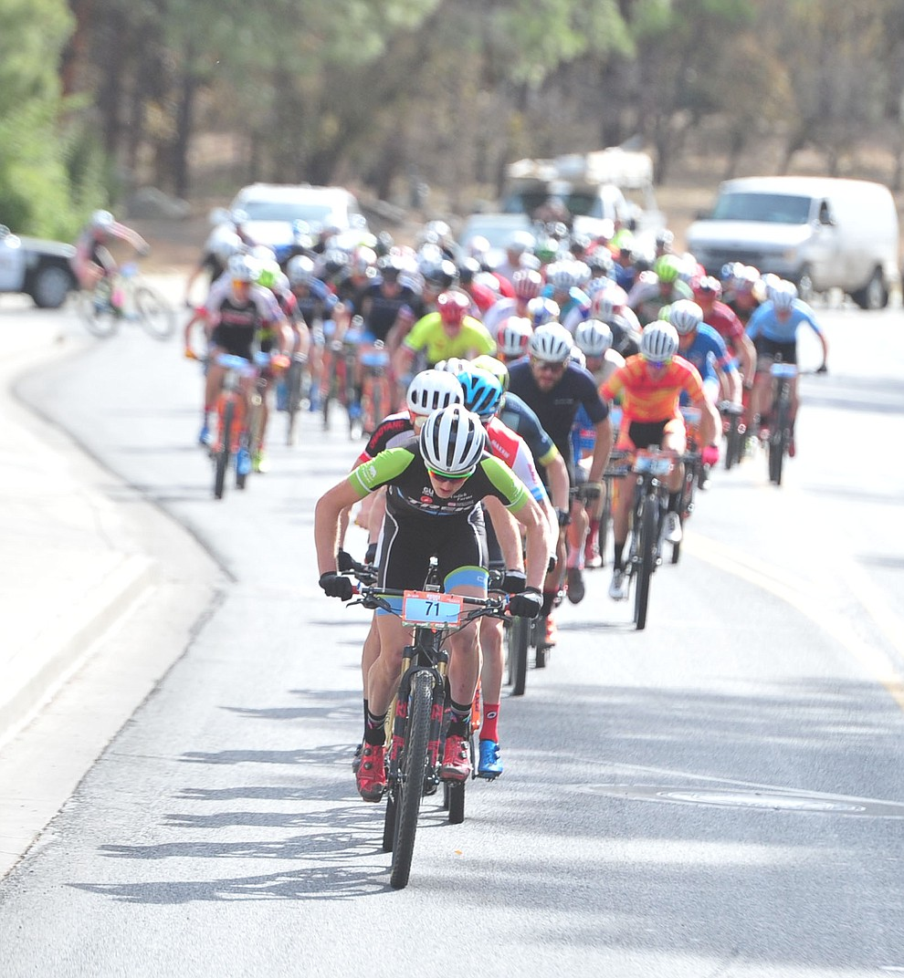 Paul Fabian leads the men as they head up to the hills from downtown during the Whiskey Off Road 50-mile professional race in Prescott Sunday, April 29, 2018. (Les Stukenberg/Courier)