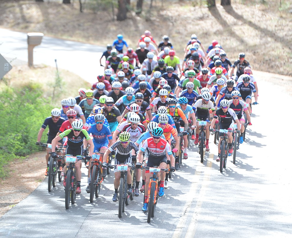 Men ride up Copper Basin Road as they head up to the trails from downtown during the Whiskey Off Road 50-mile professional race in Prescott Sunday, April 29, 2018. (Les Stukenberg/Courier)