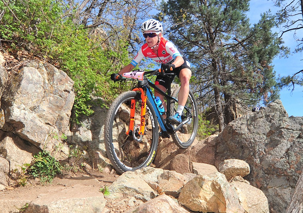 Chloe Woodruff goes through a technical section on trail 48 during the Whiskey Off Road  50 mile professional race in Prescott Sunday, April 29, 2018. (Les Stukenberg/Courier)