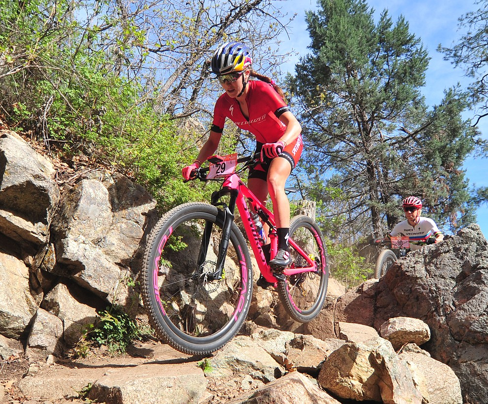 Kate Courtney goes through a technical section on trail 48 during the Whiskey Off Road  50 mile professional race in Prescott Sunday, April 29, 2018. (Les Stukenberg/Courier)