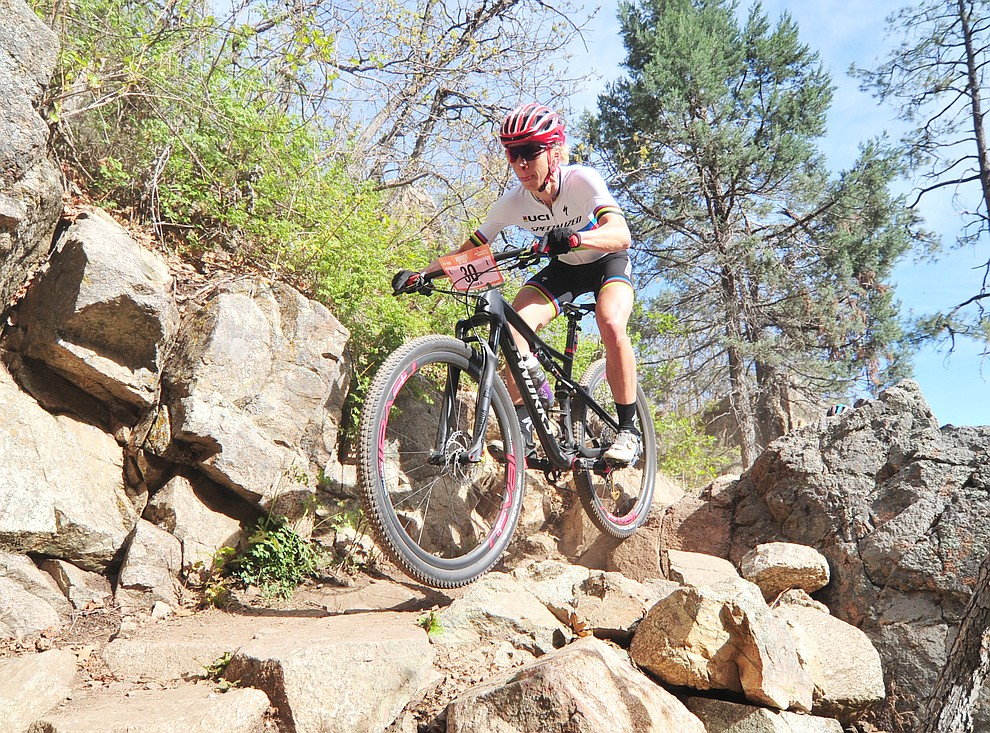 Annika Langvad goes through a technical section on trail 48 during the Whiskey Off Road  50 mile professional race in Prescott Sunday, April 29, 2018. (Les Stukenberg/Courier)