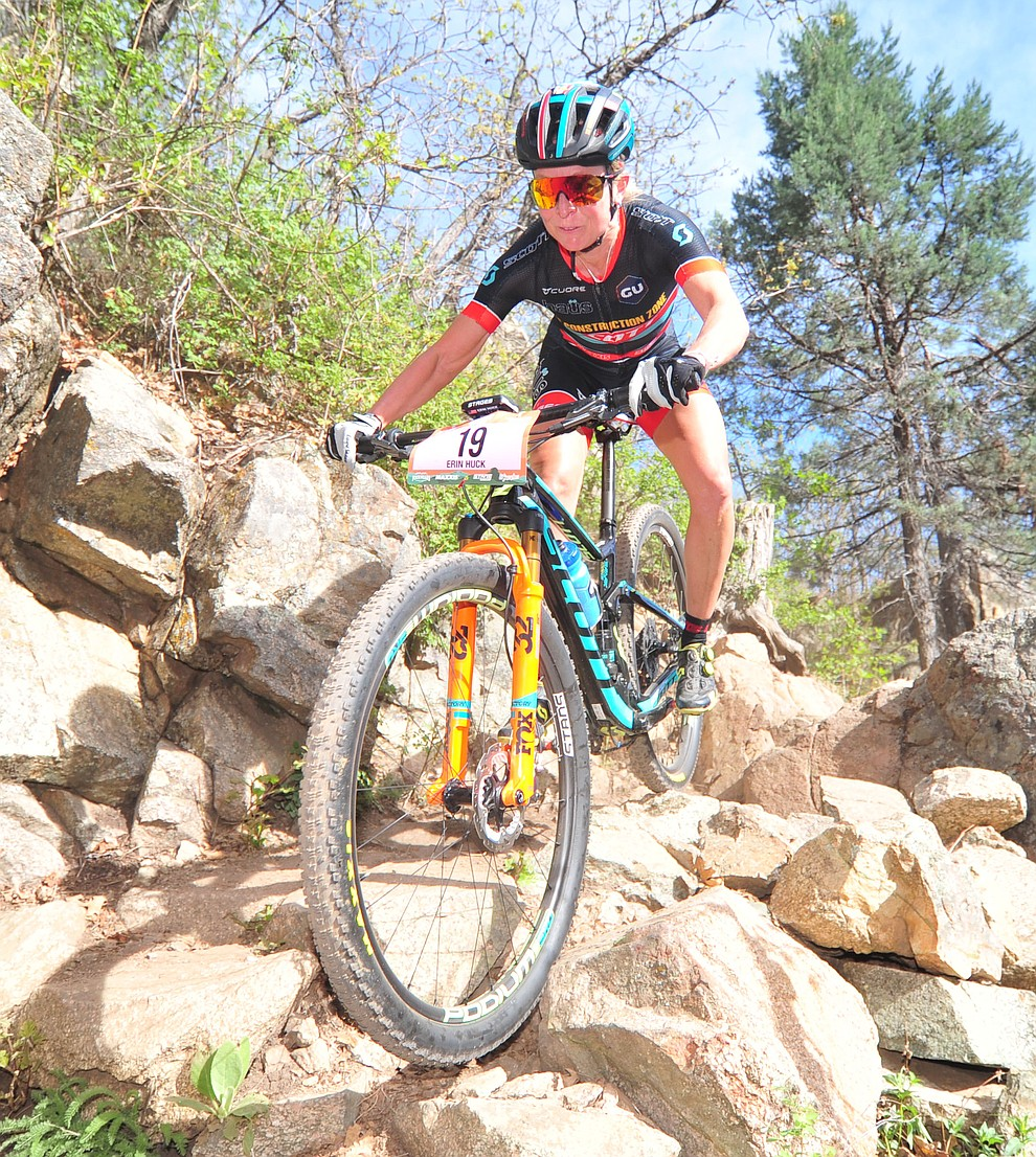Erin Huck takes a new line through a technical section on trail 48 during the Whiskey Off Road  50 mile professional race in Prescott Sunday, April 29, 2018. (Les Stukenberg/Courier)