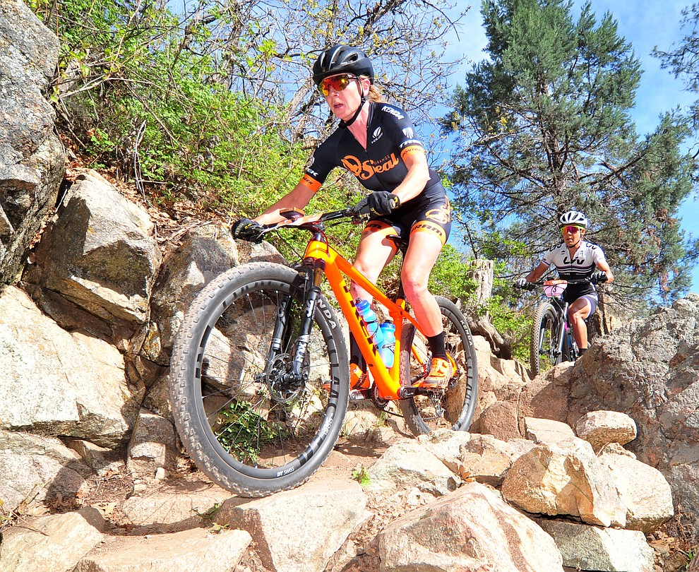 Amy Beisel goes through a technical section on trail 48 during the Whiskey Off Road  50 mile professional race in Prescott Sunday, April 29, 2018. (Les Stukenberg/Courier)