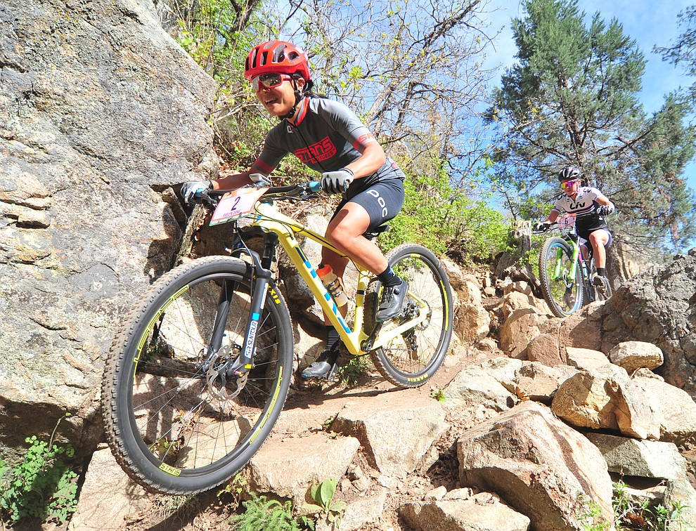 Evelyn Dong goes through a technical section on trail 48 during the Whiskey Off Road  50 mile professional race in Prescott Sunday, April 29, 2018. (Les Stukenberg/Courier)