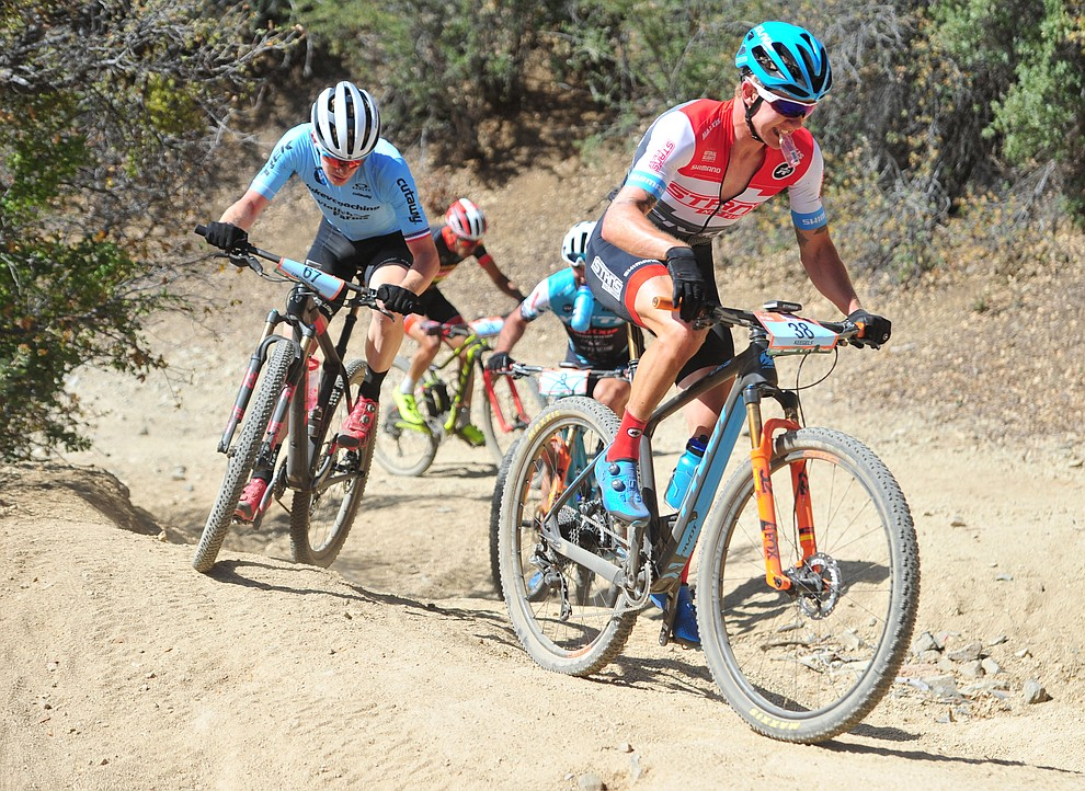 Keegan Swenson leads a group of riders on the 53 FS Road during the Whiskey Off Road  50 mile professional race in Prescott Sunday, April 29, 2018. (Les Stukenberg/Courier)