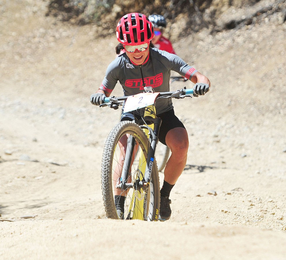 Evelyn Dong tries a news line on the 53 FS Road during the Whiskey Off Road  50 mile professional race in Prescott Sunday, April 29, 2018. (Les Stukenberg/Courier)