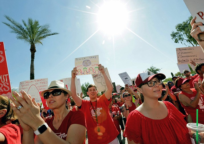 In this April 27, 2018, photo, teachers rally outside the capitol in Phoenix as part of a series of strikes across the nation over low teacher pay. The president of the American Federation of Teachers is coming to Phoenix on Monday to support Arizona teachers' call for additional school funding. Randi Weingarten will holdi a news conference next to the state capitol and also is scheduled to speak at a rally. (AP Photo/Matt York, file)