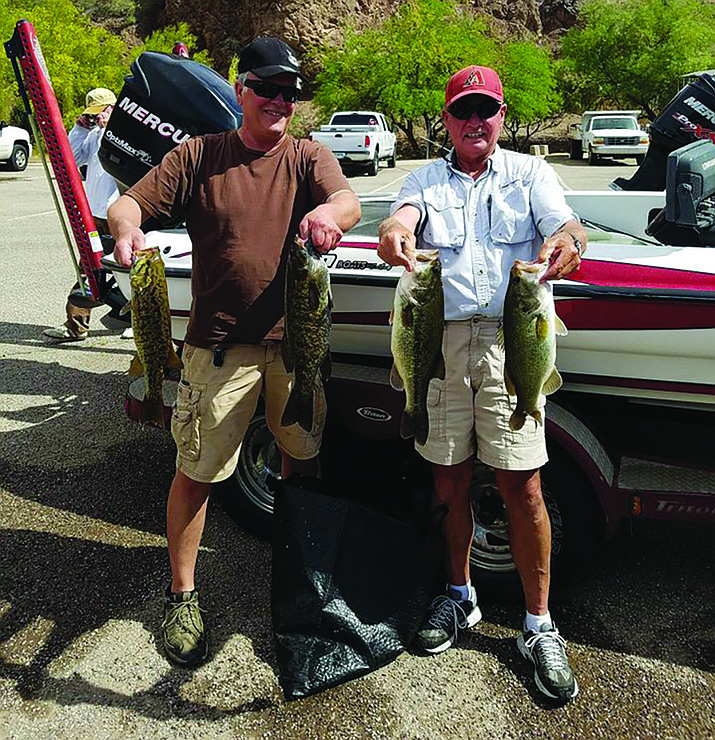 Co-winners Eric Wolsey, left, and Greg Parker show some of the bass that helped in the Kingman Bass Club tournament on the Parker Strip.