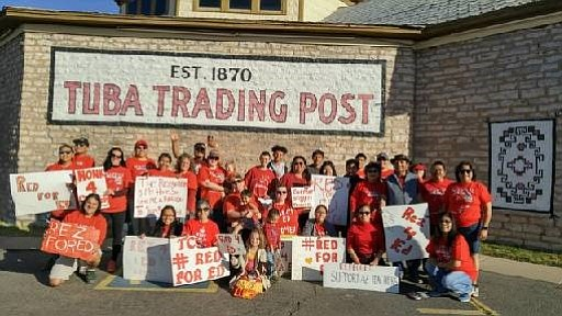 Tuba City teachers, parents and community members pose in front of the Tuba City Trading Post after walking out in support  of the state-wide education movement #RedforEd.  (Rosanda Suetopka/NHO)