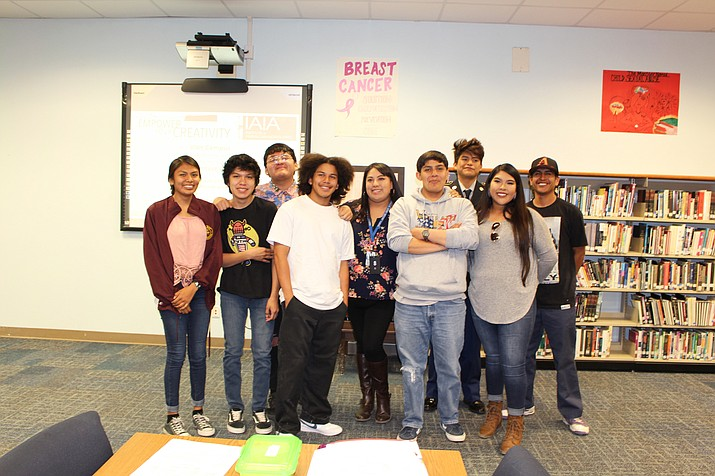 Hopi High students pose with Talia White, a spokeswoman from the Institute of American Indian Art in Santa Fe. (Stan Bindell/NHO)