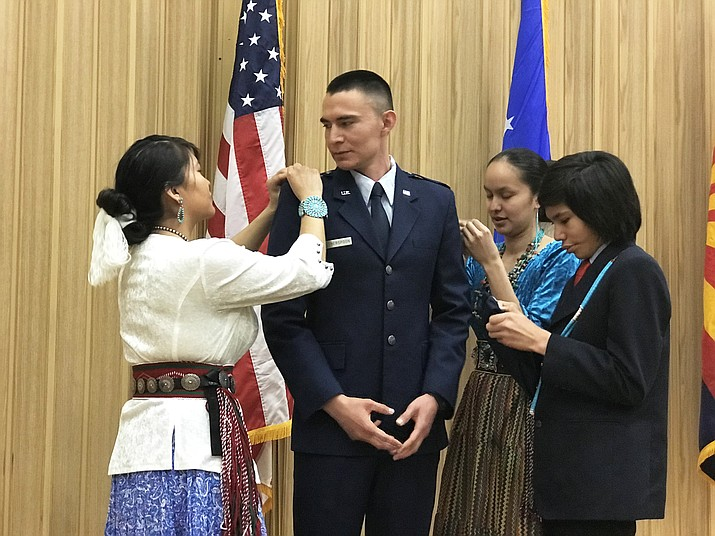 Family members participate in the commissioning ceremony for 2nd Lt. Jonathan Witherspoon at Air Force ROTC Detachment 027, Northern Arizona University, March 30. An Arizona native, Witherspoon is one of few Navajo Nation members to join the Air Force's officer corps. (Courtesy photo)