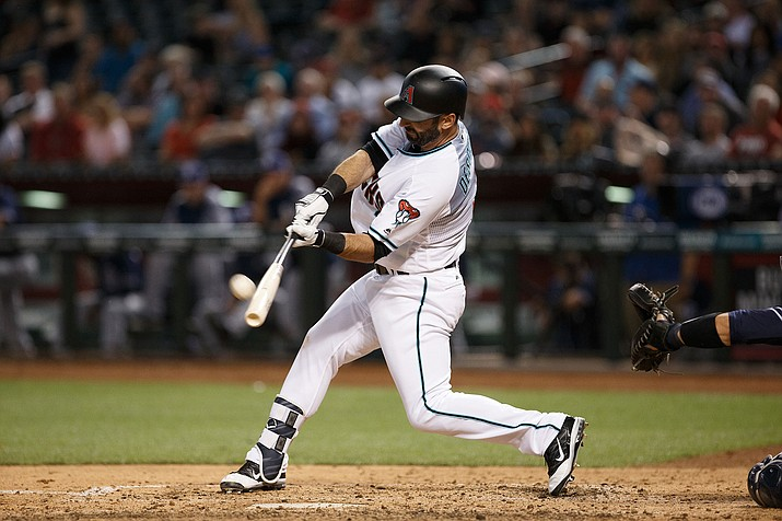 Arizona's Daniel Descalso hit a two-run, go-ahead triple in the seventh inning to give the D-backs a win over the Dodgers.