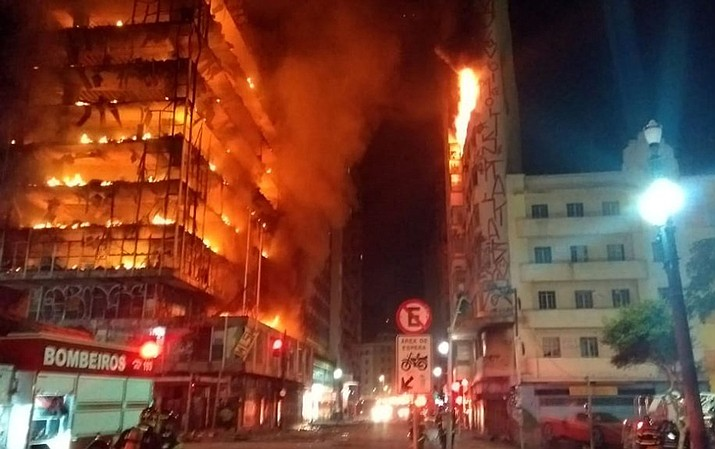 In this photo released by Sao Paulo Fire Department, a building on fire is seen in Sao Paulo, Brazil, Tuesday, May 1, 2018. A burning building in downtown Sao Paulo has collapsed as firefighters worked to put out a fire that began in the middle of the night. (Sao Paulo Fire Department)