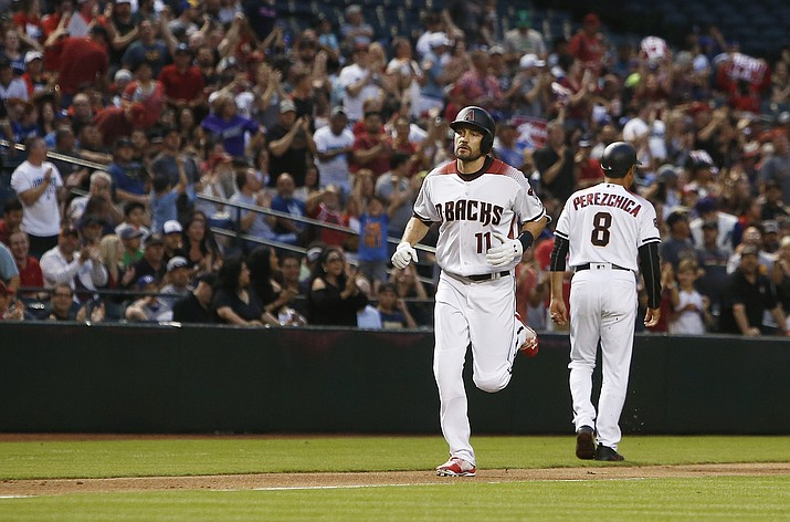 Arizona Diamondbacks' A.J. Pollock (11) rounds the bases after celebrating his home run against the Los Angeles Dodgers with third base coach Tony Perezchica (8) during the second inning of a baseball game Monday, April 30, 2018, in Phoenix. (AP Photo/Ross D. Franklin)