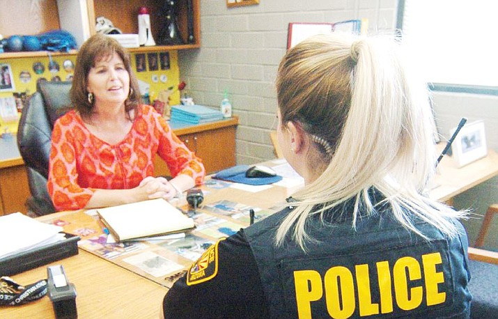 Prescott High School Principal Stephanie Hillig talks with Prescott Police officer Kayla Lubbers, who is serving as a school resource officer at the school Friday, April 20, 2018. (Les Stukenberg/Courier)