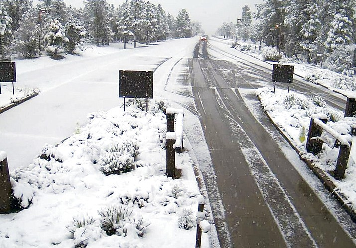 Parts of northern and eastern Arizona are getting a late taste of winter weather with snow and rain making for slick roadways Wednesday morning, May 2, 2018. This photo, taken from a remote camera, shows snow at the south gate entrance at the Grand Canyon National Park. (Arizona Department of Transportation)
