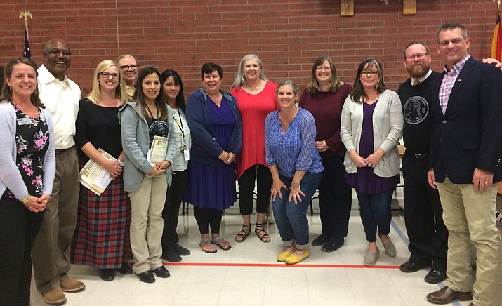 Prescott Unified Going the Extra Mile Award winners with Superintendent Joe Howard and Mayor Greg Mengarelli, a PUSD board member. From left to right: Darryl Allen, Alyson Anderson, Sheryl Blosel, Rachel Cox, Gracie Farley, Katy Harrell, Sandra Lindberg, Molly Littrell, Barbara Ouderkirk and Shelley Soifer, Joe Howard and Greg Mengarelli. (Nanci Hutson/Courier)