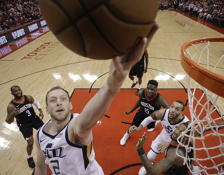 Utah Jazz forward Joe Ingles (2) drives to the basket during the first half in Game 2 of an NBA basketball second-round playoff series against the Houston Rockets, Wednesday, May 2, 2018, in Houston. (AP Photo/Eric Christian Smith)