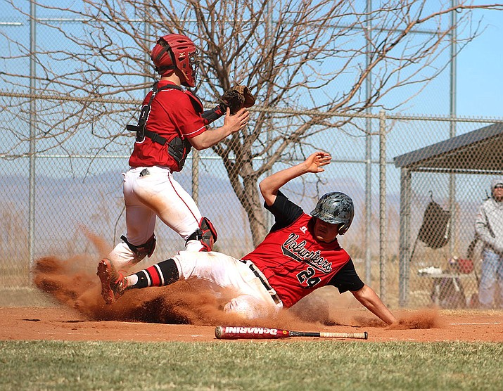 Lee Williams' Mike Bathauer, sliding home, was named 4A Grand Canyon Region Defensive Player of the Year in addition to being named to the All-Region first team as a catcher.