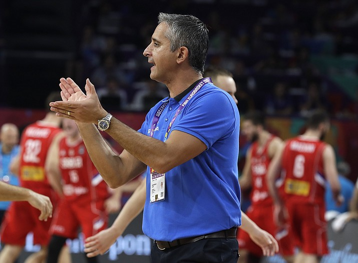 In this Sept. 17, 2017, file photo, Slovenia coach Igor Kokoskov applauds during the Eurobasket European Basketball Championship final against Serbia in Istanbul. The Phoenix Suns have hired Kokoskov, a Utah Jazz assistant, as their new head coach. The 46-year-old Serbian becomes the first NBA head coach born outside the United States. He served as a Suns assistant from 2008 to 2013, a stretch that included Phoenix's 2010 run to the Western Conference finals. (AP Photo/Thanassis Stavrakis, file)