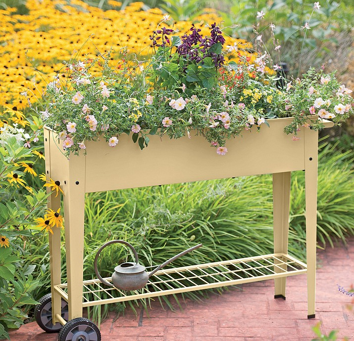 Elevated gardens are easy on your back and knees and ideal for use on a patio, balcony, deck or any area where a bit of planting space is desired. (Courtesy)