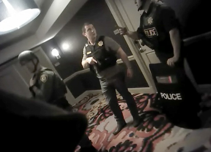 This photo from police officer video body camera footage on Oct. 1, 2017, provided by the Las Vegas Metropolitan Police Department, shows officers searching hallways during the deadliest mass shooting in modern U.S. history by Stephen Paddock, at the Mandalay Bay Hotel in Las Vegas, released Wednesday, May 2, 2018. (Las Vegas Metropolitan Police Department via AP)