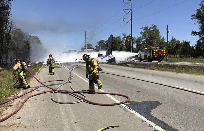 This photo made available by the Chatham Emergency Services, GA., shows firefighters putting out a fire caused by a plane crash near the airport in Savannah, Ga., Wednesday, May 2, 2018. An Air National Guard C-130 cargo plane crashed killing five people. (Chuck Kearns/Chatham Emergency Services via AP)