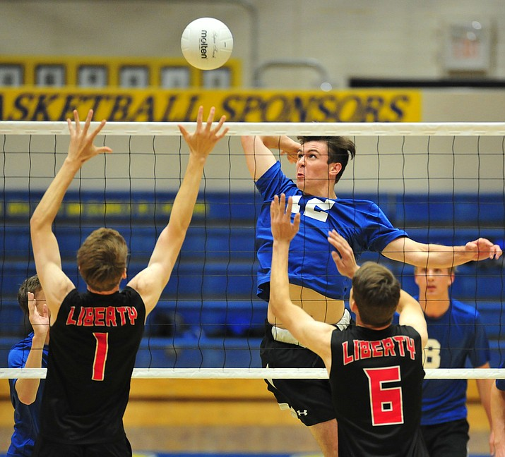 Prescott's Paul Kinach lines up a kill as the Badgers hosted Liberty in a Arizona Interscholastic Association State Volleyball Play-in game Thursday, May 3, 2018 in Prescott. (Les Stukenberg/Courier)
