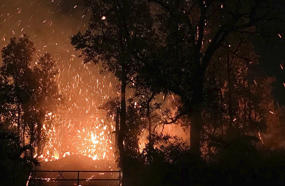 This photo provided by Shane Turpin shows results of the eruption from Kilauea Volcano on Hawaii's Big Island Friday, May 4, 2018. The eruption sent molten lava through forests and bubbling up from paved streets and forced the evacuation of about 1,500 people who were still out of their homes Friday after Thursday's eruption. (Shane Turpin/seeLava.com via AP)