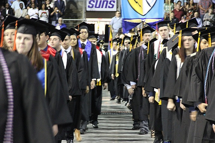 Embry-Riddle Aeronautical University students line up before taking their seats during the university's 2017 graduation ceremony, which took place inside the Prescott Valley Event Center.
