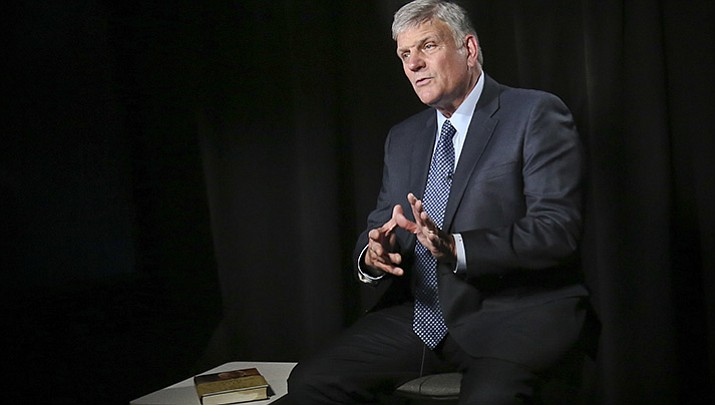 "In this May 1, 2018, photo, the Rev. Franklin Graham speaks during an interview about his latest book ""Through my Father's Eyes,"" about his father the late evangelist Billy Graham in New York. Billy Graham's oldest son, Franklin, says his new book about his father is meant to share lessons he learned from the man known as ""America's Pastor."" (AP Photo/Bebeto Matthews)"