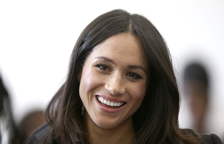 In this Wednesday April 18, 2018 file photo, Meghan Markle attends a reception with Britain's Prince Harry for the Commonwealth Youth Forum at the Queen Elizabeth II Conference Centre, London, during the Commonwealth Heads of Government Meeting. Royal officials said Friday May 4, 2018, Meghan Markle's divorced parents Thomas Markle and Doria Ragland will come to London before her May 19 wedding to Prince Harry and will meet with Queen Elizabeth II and other royals. (Yui Mok/Pool via AP, File)
