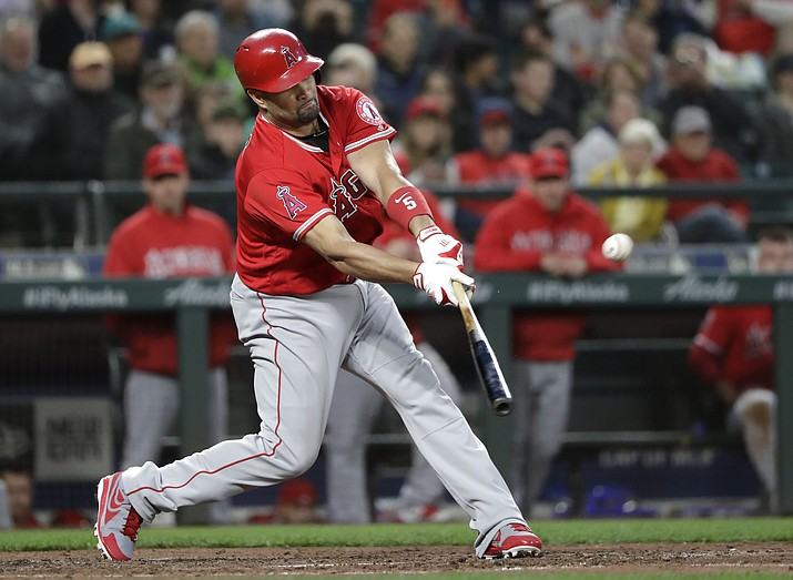 Los Angeles Angels' Albert Pujols singles against the Seattle Mariners in the fifth inning of a baseball game Friday, May 4, 2018, in Seattle. The hit was his 3,000th career hit. (Elaine Thompson/AP)