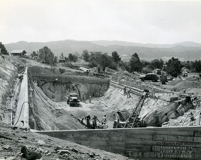 LEFT: Reservoir construction off Douglas Street above the east side of Willow Creek Road.  The view of the photo is looking east, 1947-1948. (Sharlot Hall Museum/Courtesy, Call number 1977.0215.0056)