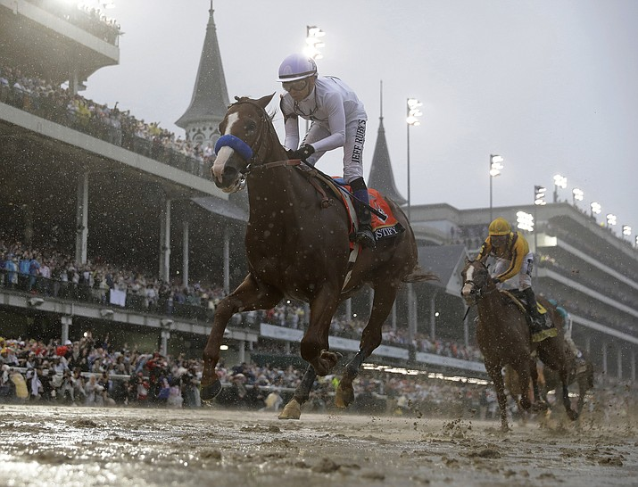 Mike Smith rides Justify to victory during the 144th running of the Kentucky Derby at Churchill Downs Saturday.