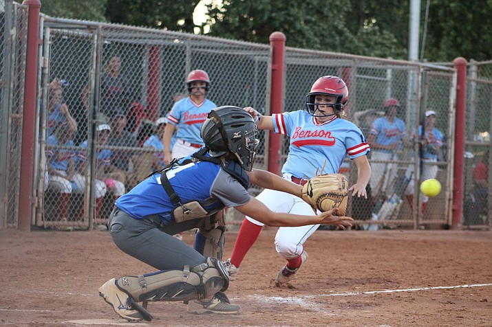 Academy'sLynsey Day takes a throw at home to get a Benson runner out at the plate, but the Bobcats went on to score 14 other runs and eliminate the Lady Tigers from the 2A State Tournament, 14-0.