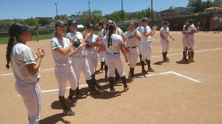 Yavapai College's softball players gather near the home dugout Saturday at Bill Vallely Field in Prescott to clap for their fans who supported them during a 50-win season in 2018. The top-seeded Roughriders lost to Central Arizona, 3-2, in an NJCAA Division I, Region I elimination game. Eastern Arizona later defeated Central Arizona to win the region and advance to nationals. (Doug Cook/Courier)
