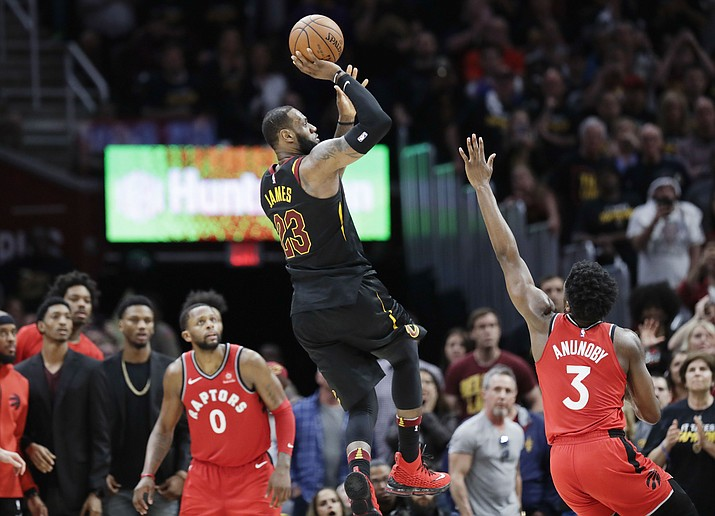 Cleveland Cavaliers' LeBron James (23) hits the game-winning shot as Toronto Raptors' CJ Miles (0) looks on during the second half of Game 3 of an NBA basketball second-round playoff series, Saturday, May 5, 2018, in Cleveland. The Cavaliers defeated the Raptors 105-103. (Tony Dejak/AP)