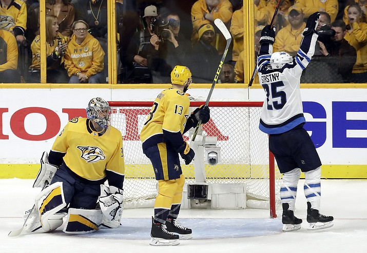 Winnipeg Jets center Paul Stastny (25) celebrates after scoring a goal against Nashville Predators goalie Pekka Rinne, left, of Finland, during the second period in Game 5 of an NHL hockey second-round playoff series Saturday, May 5, 2018, in Nashville, Tenn. Also defending for the Predators is Nick Bonino (13). (AP Photo/Mark Humphrey)