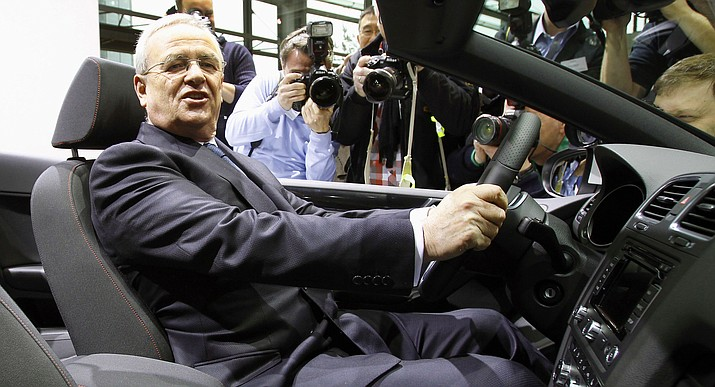 In this March 12, 2012, file photo, Volkswagen CEO Martin Winterkorn poses for the media in Wolfsburg, Germany. Winterkorn later resigned, when a federal grand jury in Detroit indicted him on charges stemming from the company's diesel emissions cheating scandal in a plot that prosecutors allege reached the top of the world's largest automaker. (AP Photo/Michael Sohn,file)