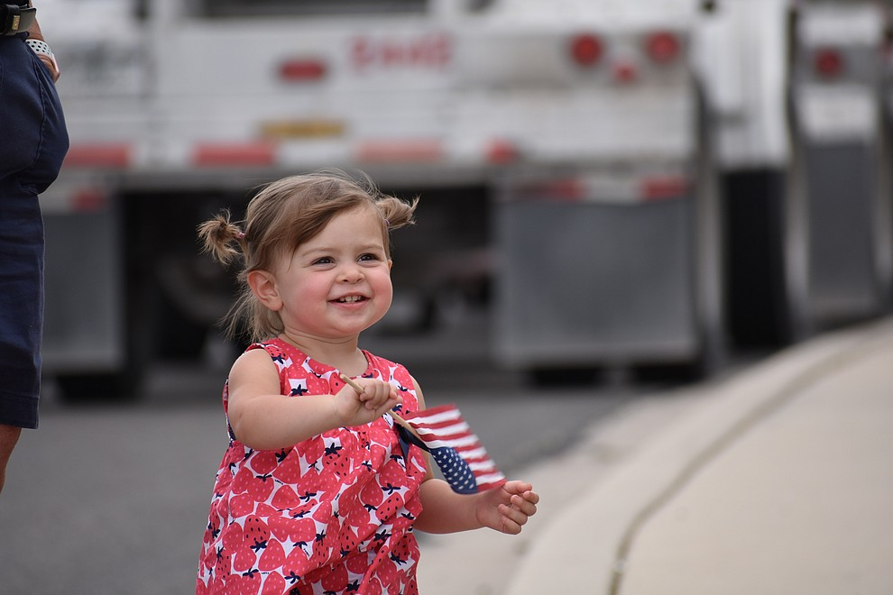Military families and other members of the public cheer on National Guard Infantry Unit Charlie Company 1st Battalion-158 as they parade around the Civic Center in Prescott Valley on Sunday, May 6, 2018 in anticipation of their deployment to Afghanistan. (Richard Haddad/WNI)
