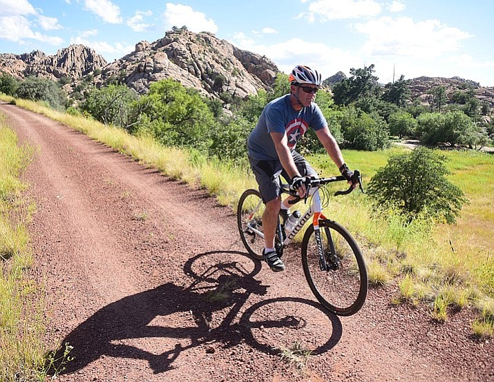 In this 2017 file photo Matt Fay of Prescott Valley rides along the Peavine Trail on a stretch north of the Point of Rocks that is being eyed for residential development by Arizona Eco Development. Representatives from the company will hold an open house regarding their proposed development at 5 p.m. Tuesday, May 8, immediately after the City Council meeting in the Council Chambers, 201 S. Cortez St., Prescott. (Les Stukenberg/Courier file)