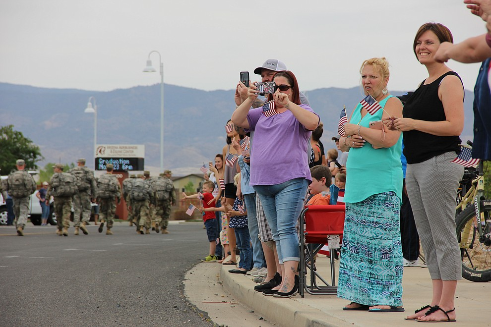 Military families and other members of the public cheer on National Guard Infantry Unit Charlie Company 1st Battalion-158 as they parade around the Civic Center in Prescott Valley on Sunday, May 6, 2018 in anticipation of their deployment to Afghanistan. (Max Efrein/Daily Courier)