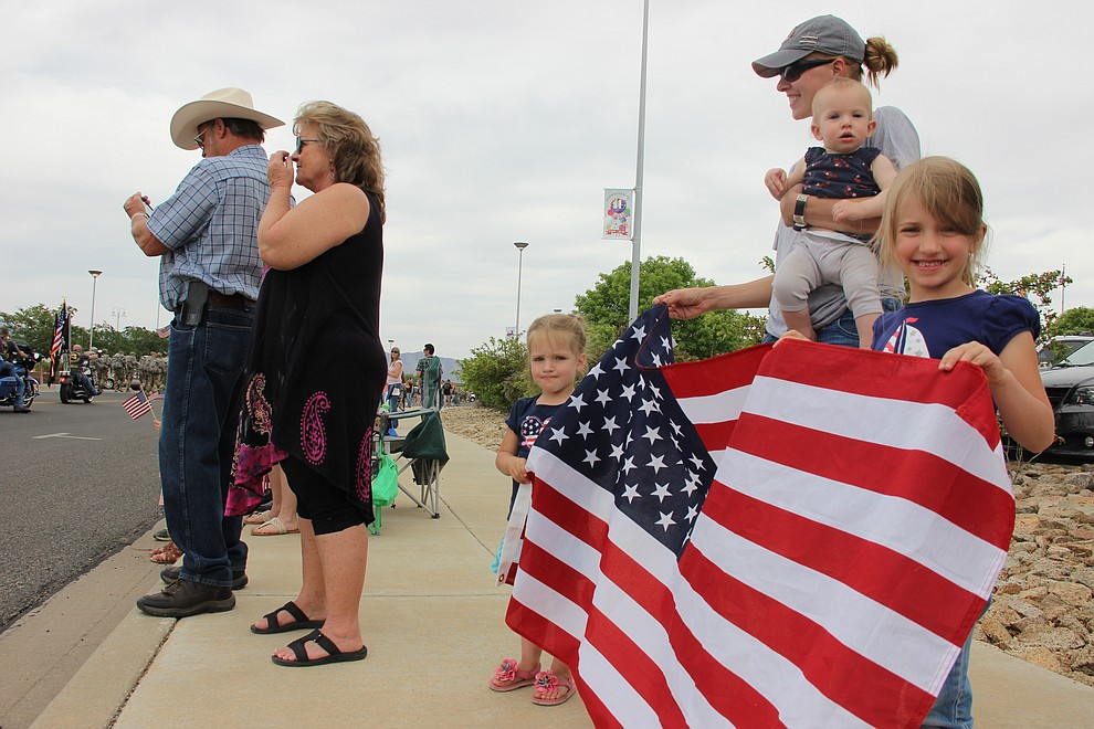 A local family watch and cheer on National Guard Infantry Unit Charlie Company 1st Battalion-158 as they parade around the Civic Center in Prescott Valley on Sunday, May 6, 2018 in anticipation of their deployment to Afghanistan. (Max Efrein/Daily Courier)