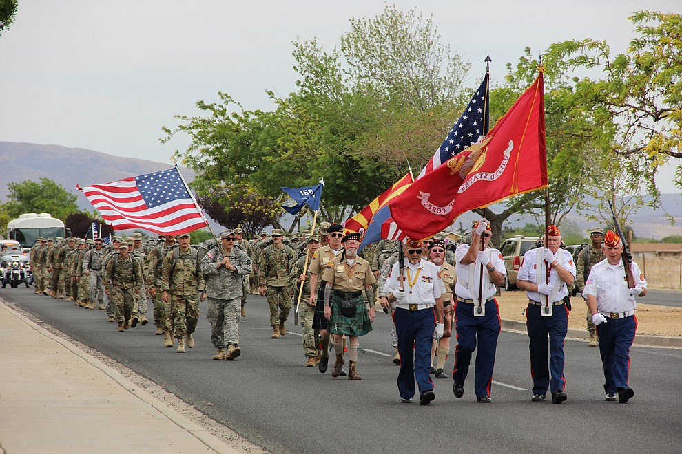 The Marine Corps League Honor Guard heads up a parade for National Guard Infantry Unit Charlie Company 1st Battalion-158 in honor of the company's anticipated deployment to Afghanistan. The parade took place in Prescott Valley on Sunday, May 6, 2018. (Max Efrein/Daily Courier)