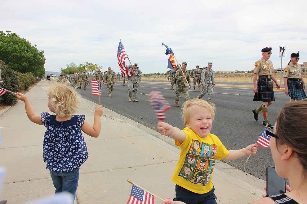 Robbie Garcia gets excited when he sees his dad, Robert Garcia, marching with National Guard Infantry Unit Charlie Company 1st Battalion-158. Charlie Company is set to deploy to Afghanistan as part of Operation Freedom's Sentinel. (Max Efrein/Daily Courier)