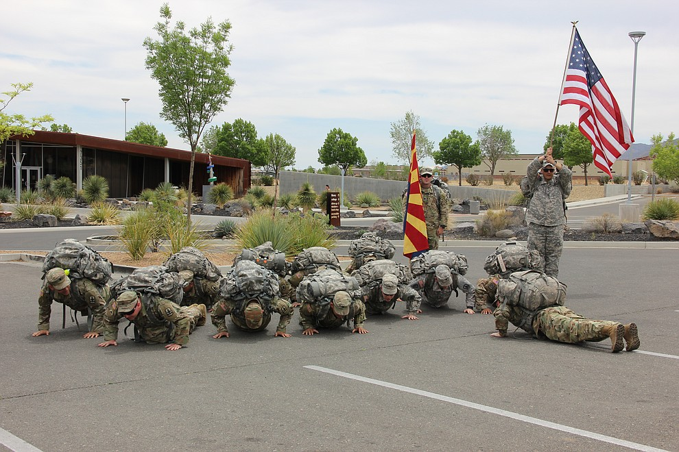 Troops with National Guard Infantry Unit Charlie Company 1st Battalion-158 do pushups right after a deployment parade hosted for them in Prescott Valley on Sunday, May 6, 2018. (Max Efrein/Daily Courier)