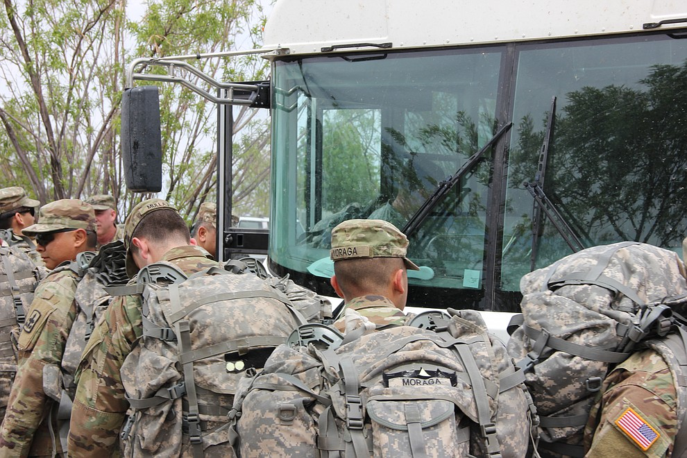 Troops with National Guard Infantry Unit Charlie Company 1st Battalion-158 get on a bus in anticipation of their deployment from the Prescott area to Afghanistan. The company paraded around the Civic Center in Prescott Valley on Sunday, May 6, 2018. (Max Efrein/Daily Courier)