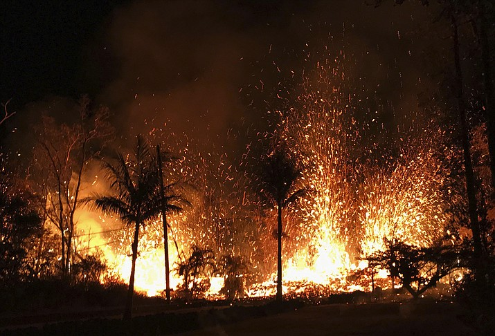 In this Saturday, May 5, 2018 photo, a new fissure erupts in Leilani Estates in Pahoa, Hawaii. Hawaii's erupting Kilauea volcano has destroyed homes and forced the evacuations of more than a thousand people. (U.S. Geological Survey)